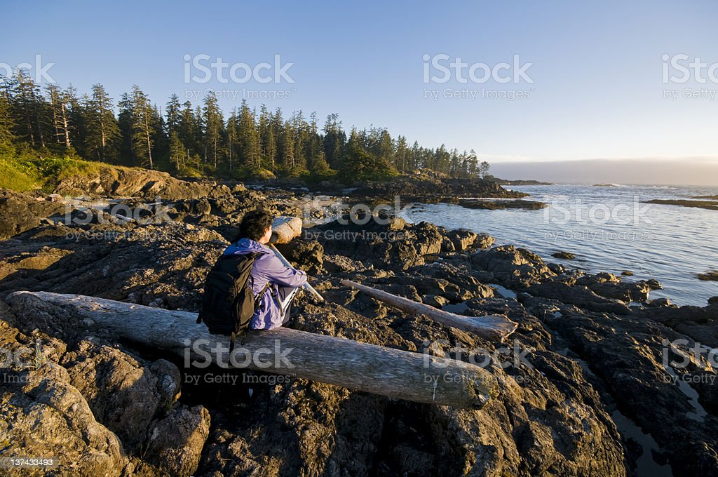 woman with backpack enjoying the view stock photo