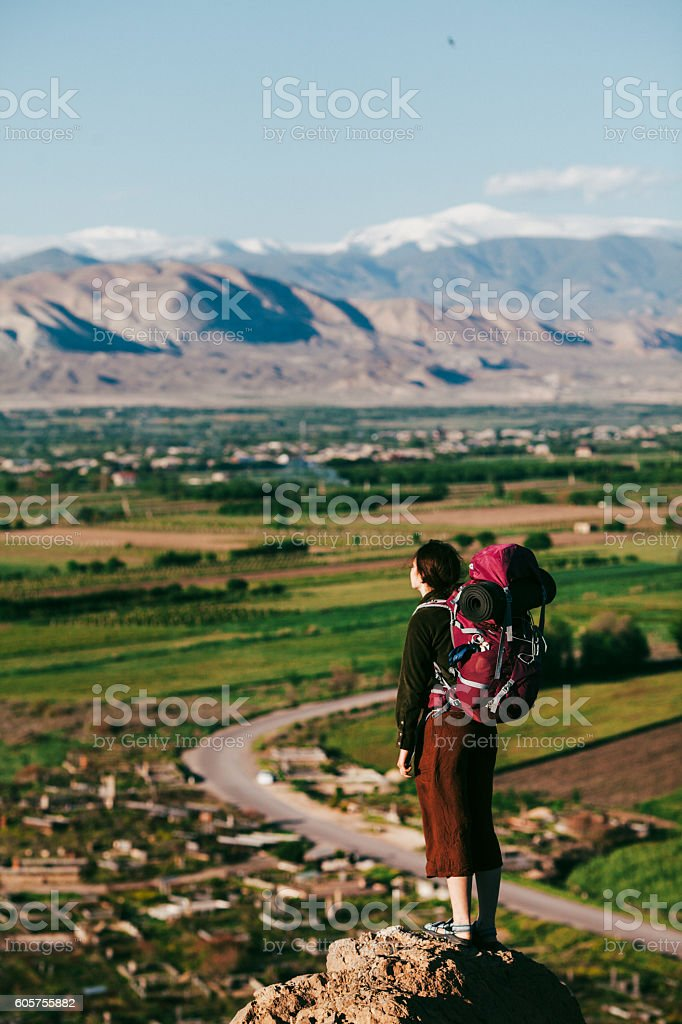 Woman with backpack on the background of Ararat stock photo