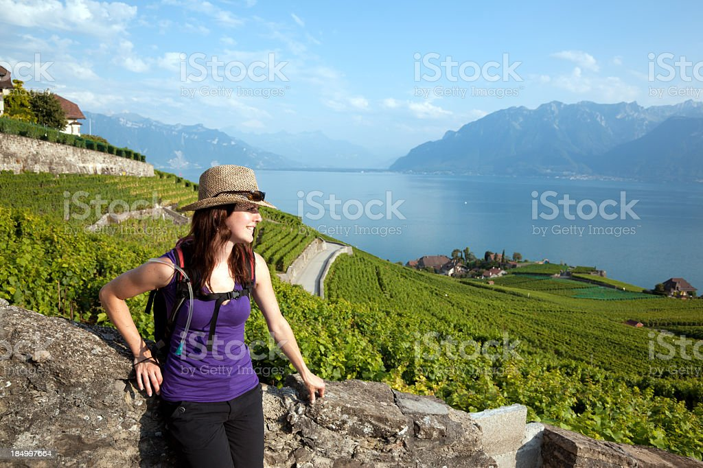 Woman with Backpack Walking in Vineyard, Montreaux, Switzerland stock photo