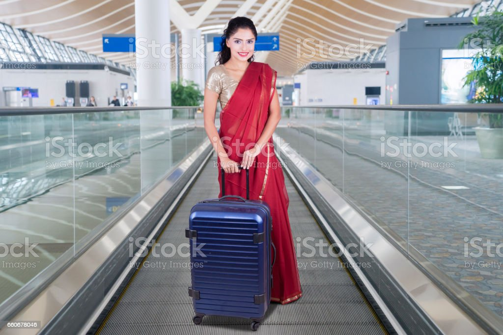 Woman with bag and saree clothes stock photo