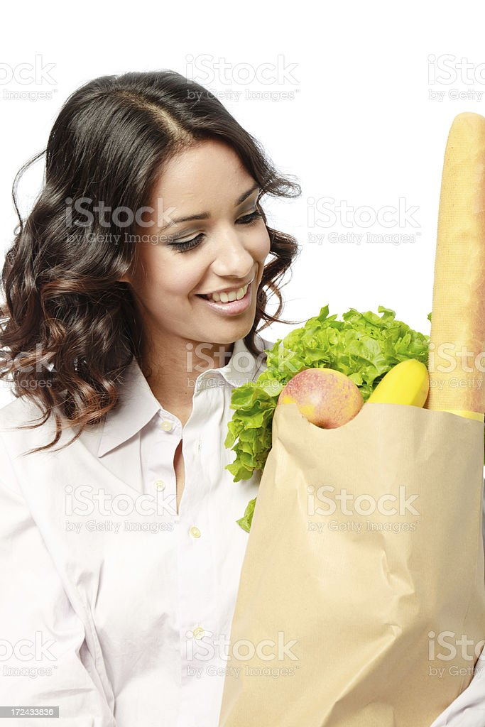 Woman with bag of fresh groceries royalty-free stock photo