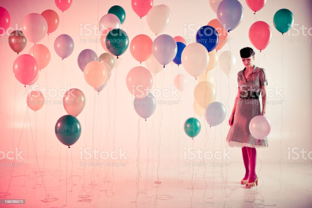Woman with balloons royalty-free stock photo