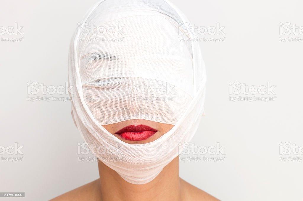 Woman with bandage stock photo