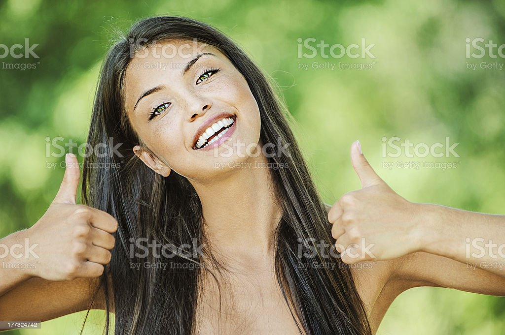 woman with bare shoulders happily raises his thumb up royalty-free stock photo