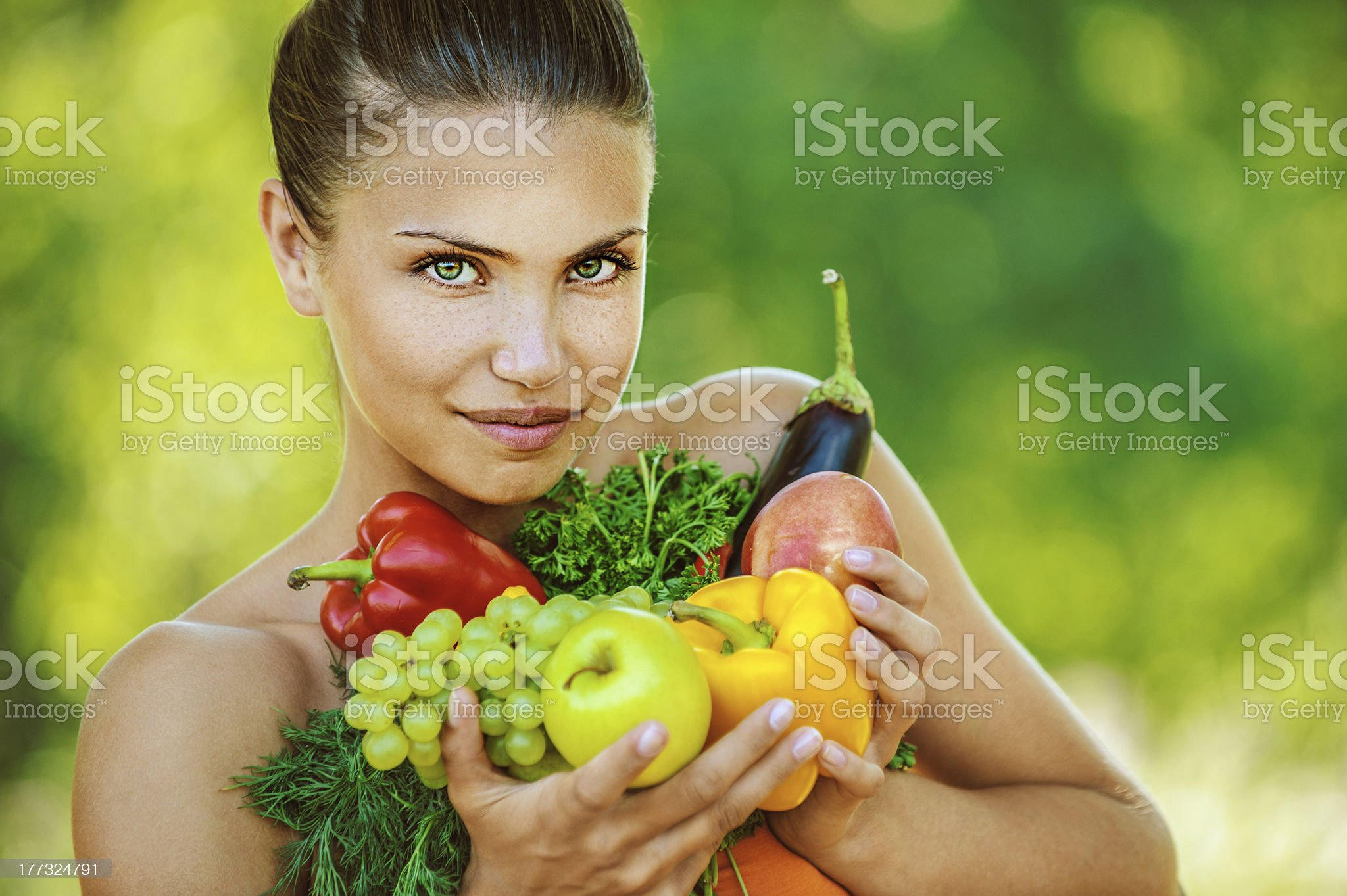 woman with bare shoulders holding fruit and vegetables royalty-free stock photo
