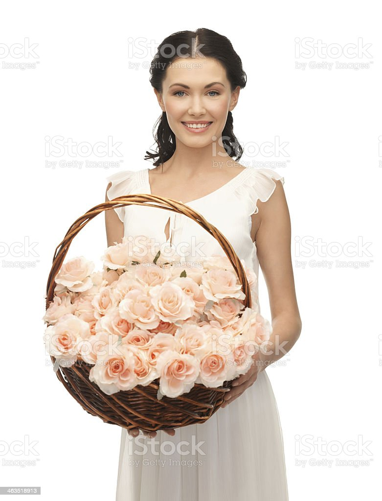 woman with basket full of flowers stock photo