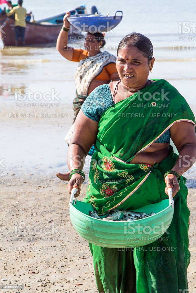 Woman with basket of fish, Murudeshwar, Karnataka, India stock photo
