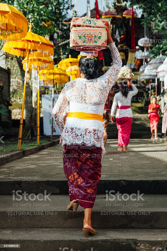 Woman with basket on the head stock photo