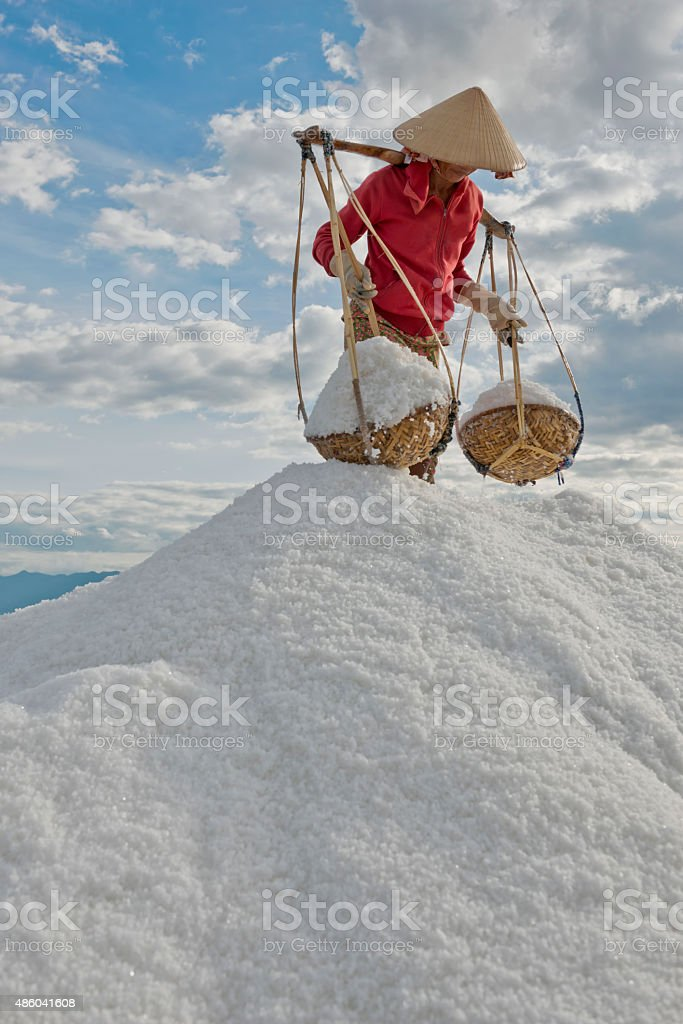 Woman with Baskets of Sea Salt stock photo
