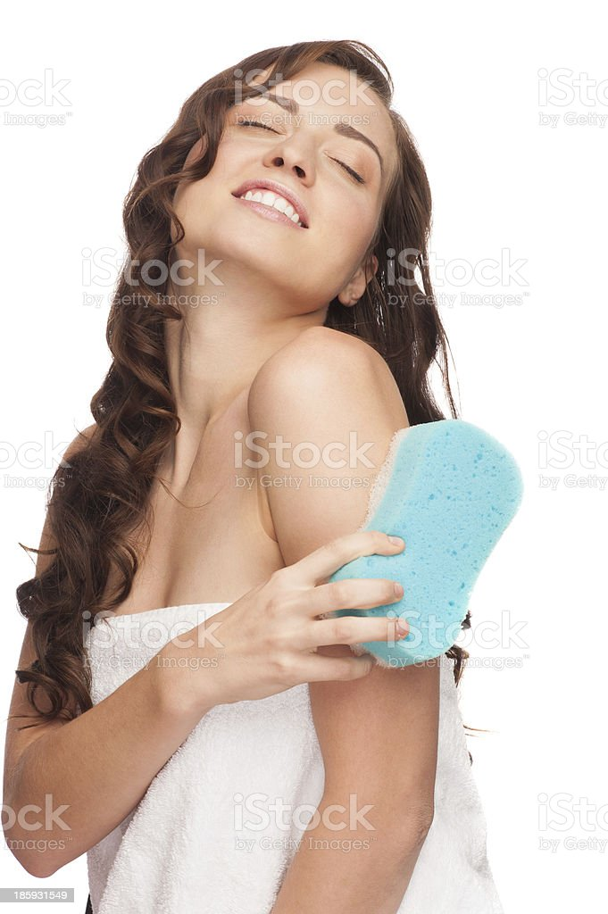 Woman with bath sponge royalty-free stock photo