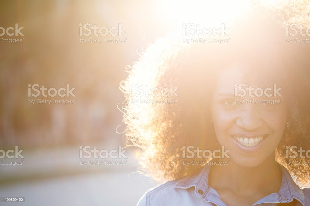 Woman with beautiful afro looking at camera. stock photo