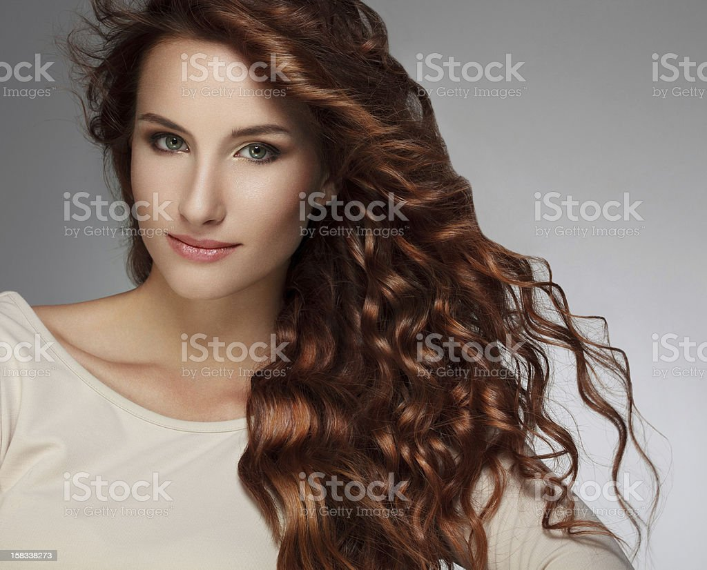 Woman with Beautiful Curly Hair stock photo