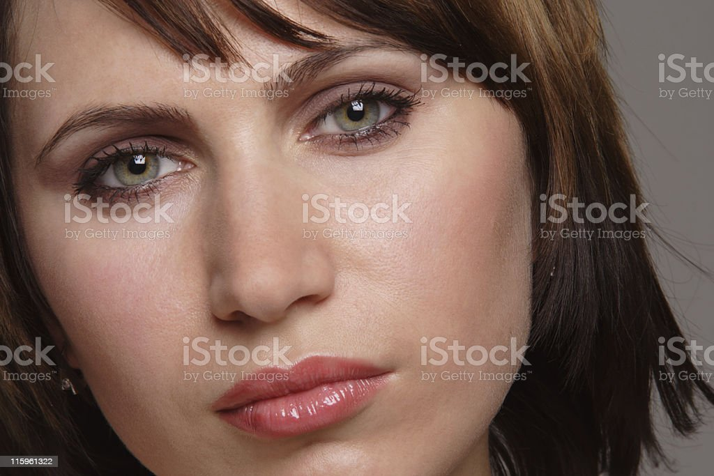 A woman with beautiful eyes looking into the camera royalty-free stock photo