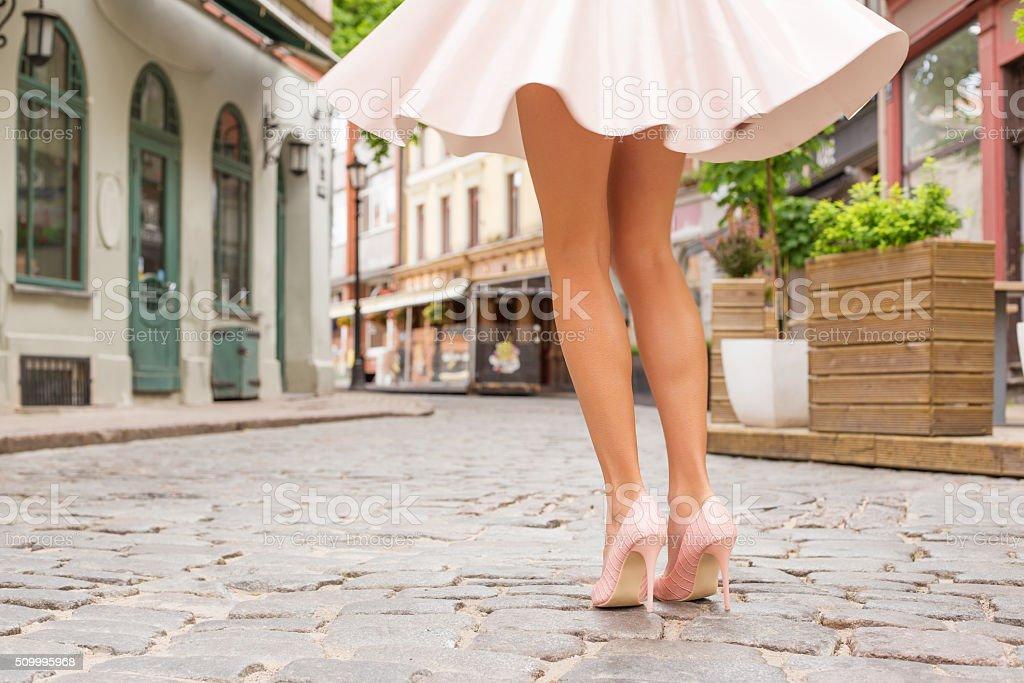 Woman with beautiful legs wearing high heel shoes stock photo