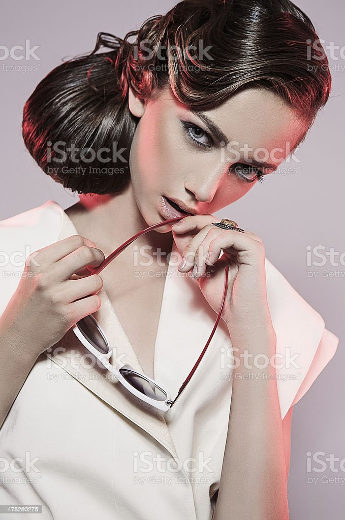 Woman with beauty hairstyle and sunglasses royalty-free stock photo