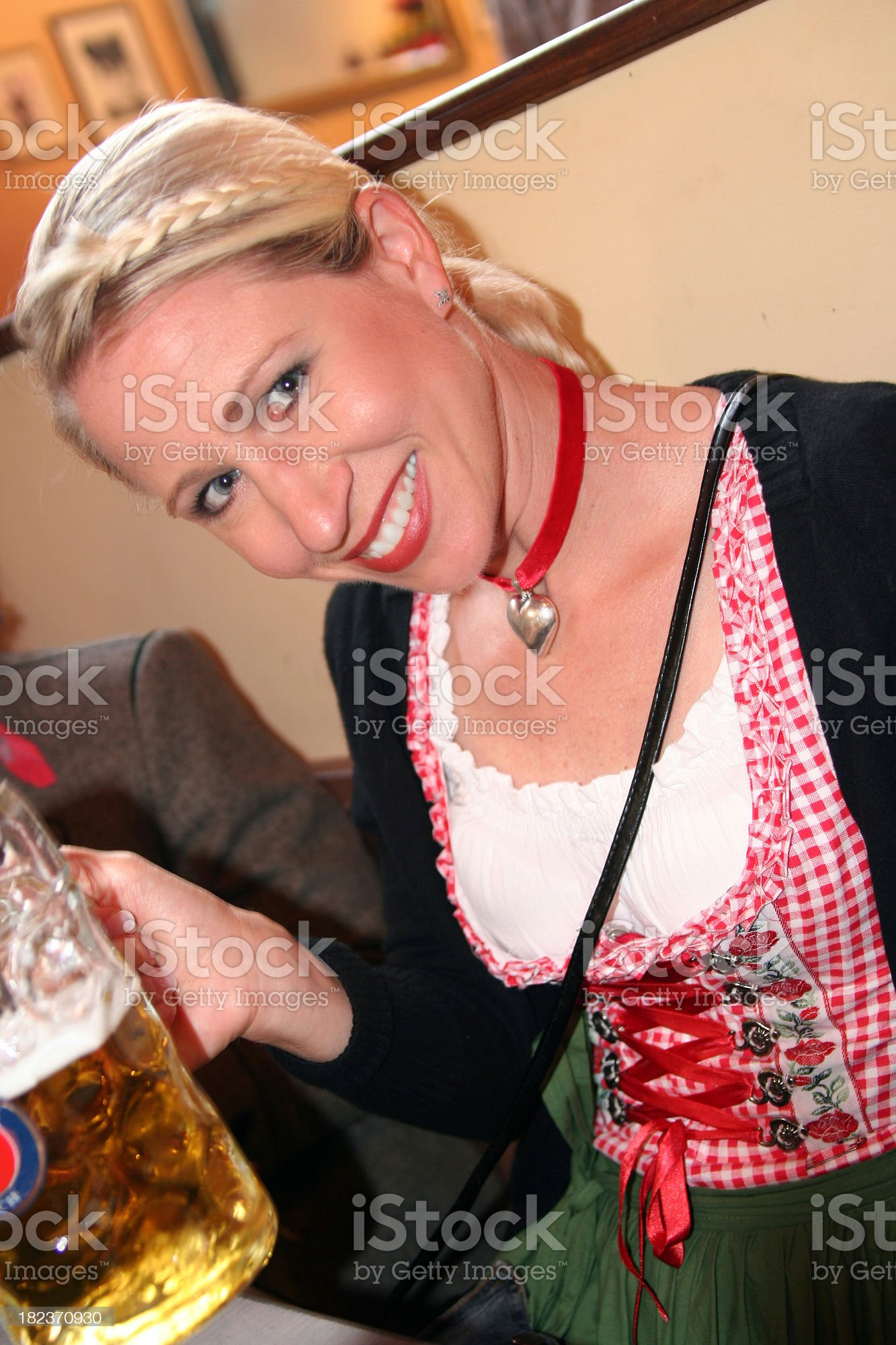 Woman with beer mug and dirndl on the octoberfest royalty-free stock photo