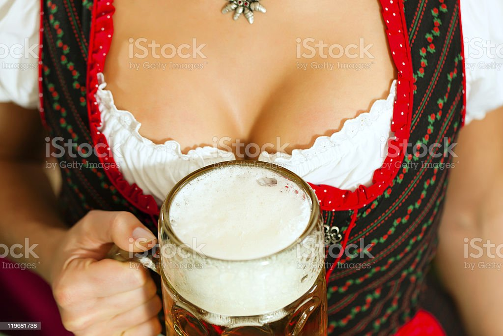 Woman with beer on décolleté in Bavaria stock photo