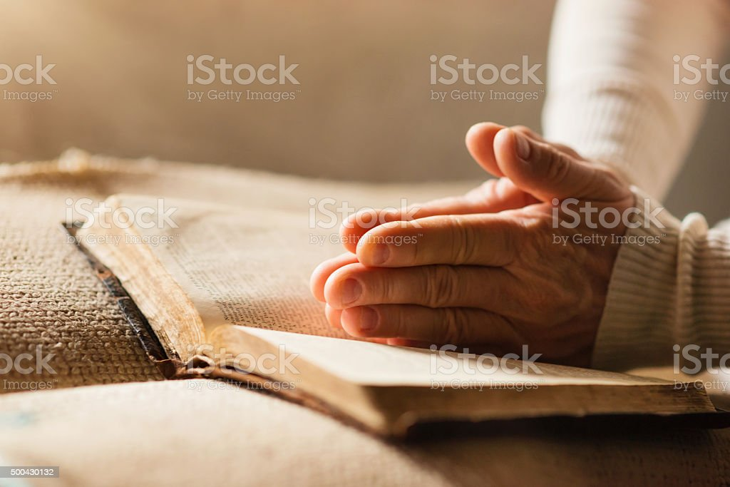Woman with bible stock photo