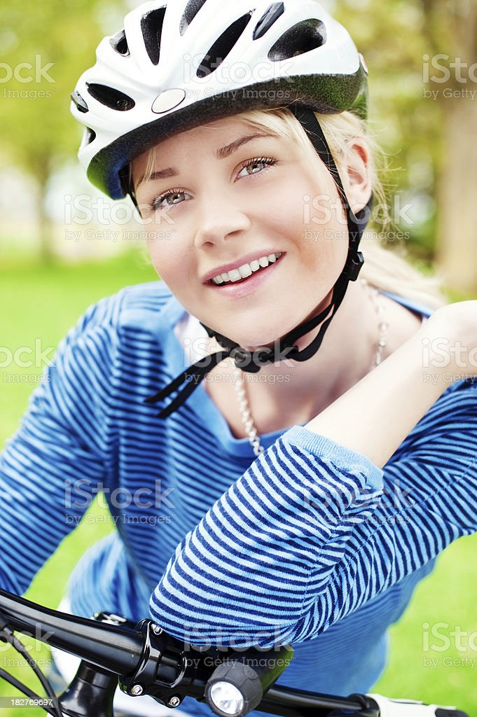 Woman with bicycle and helmet royalty-free stock photo