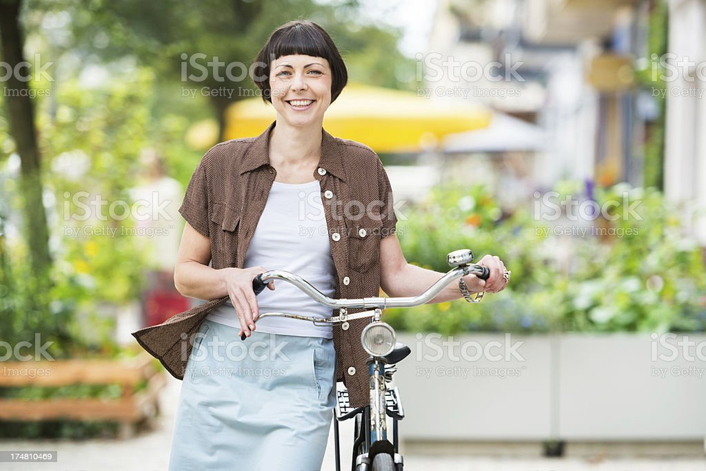 Woman with Bicycle in Berlin, Germany stock photo