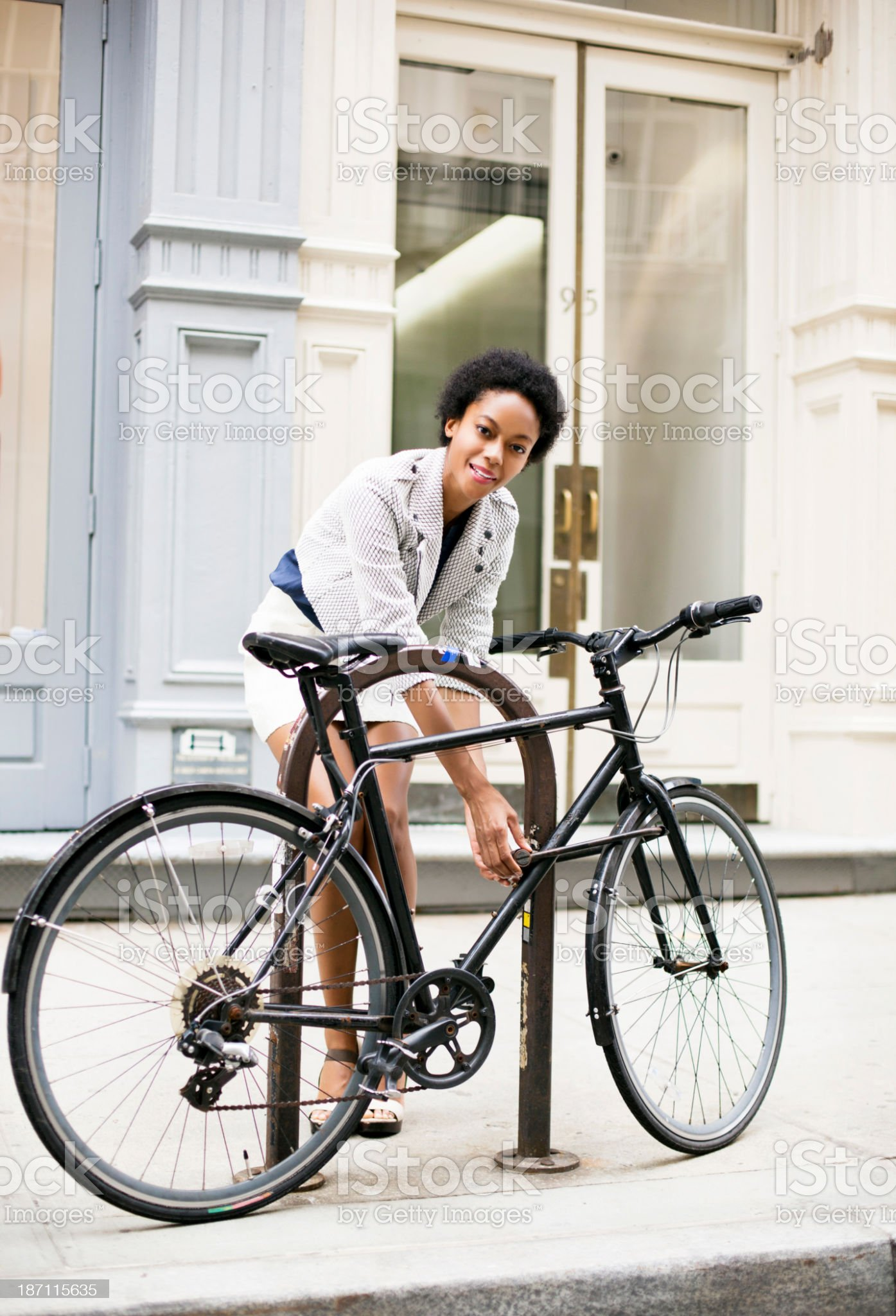 Woman with bicycle in the Soho royalty-free stock photo