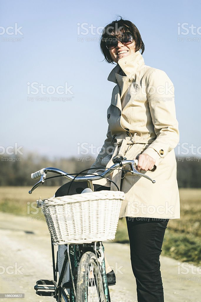 Woman with bicycle the countryside royalty-free stock photo