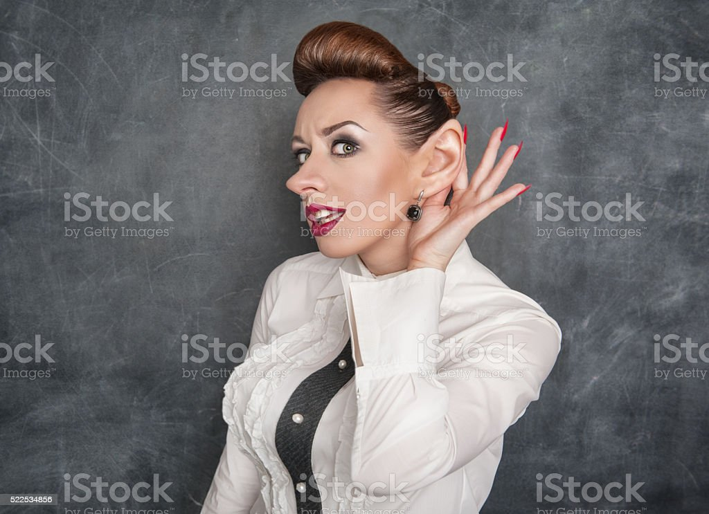 Woman with big ear eavesdropping stock photo