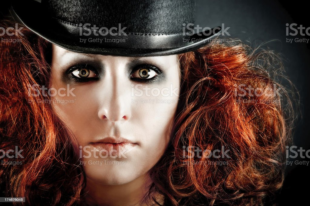 Woman with big hair and top hat stock photo
