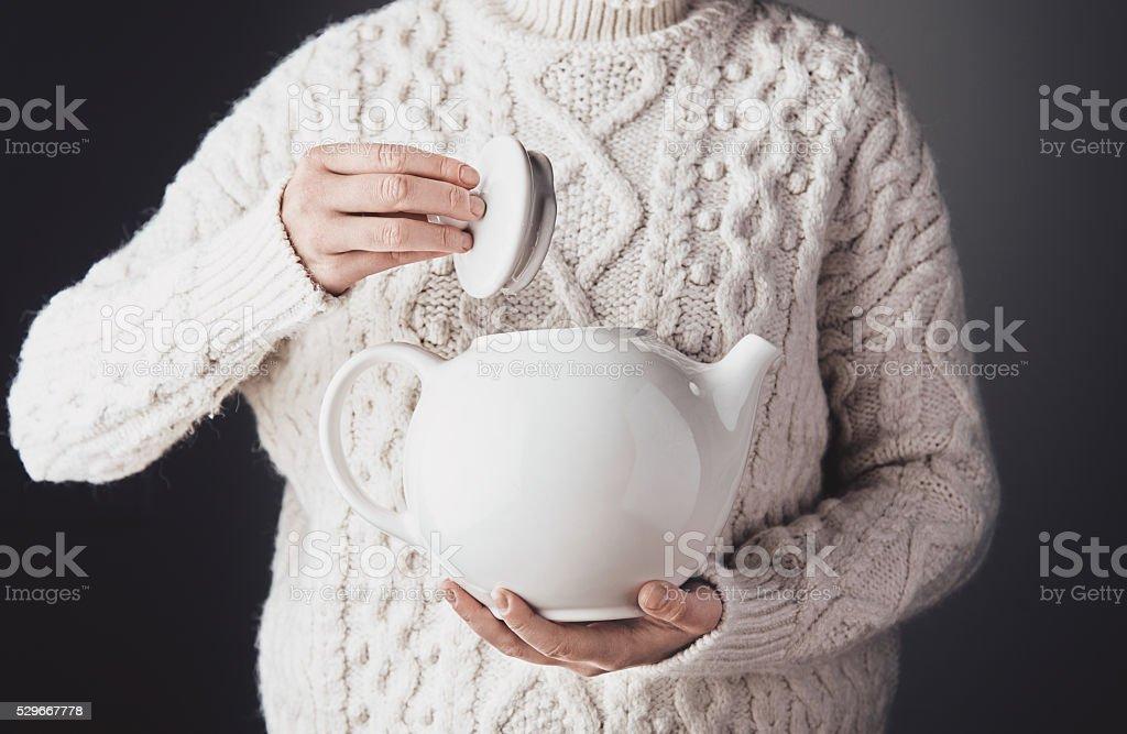 Woman with big teapot stock photo