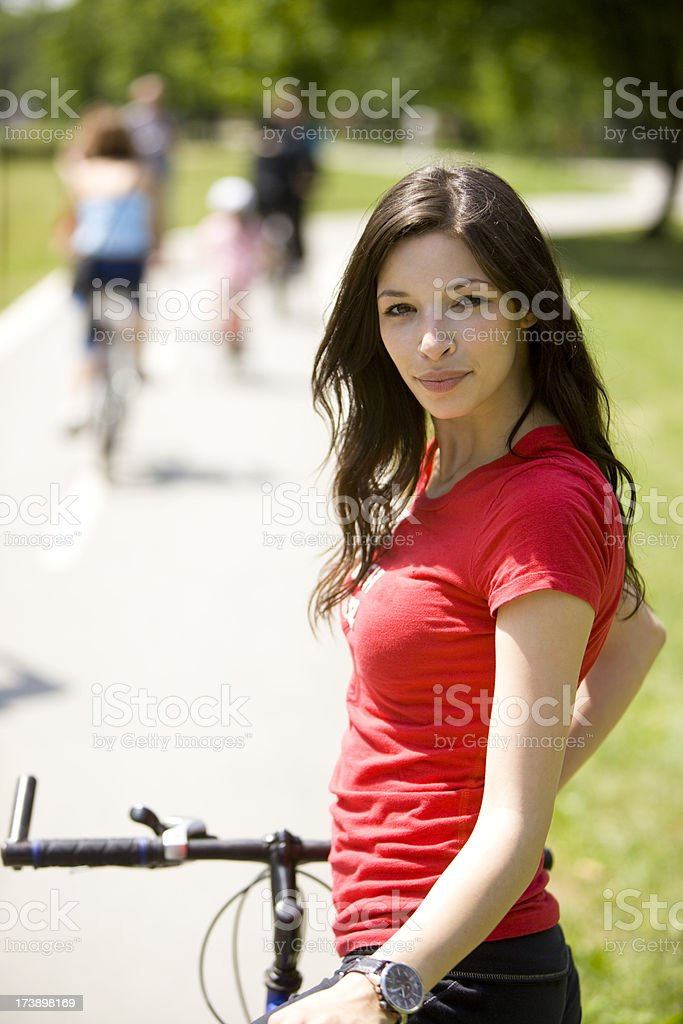 Woman with bike royalty-free stock photo