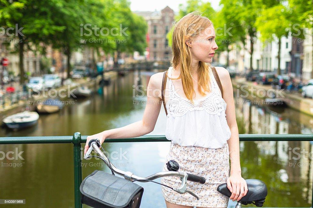 Woman with bike stock photo