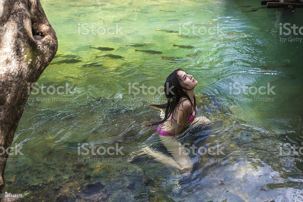 Woman with bikini swimming in the waterfall of Bonito ,Brazil. stock photo