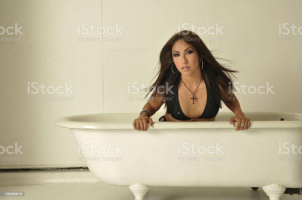 Woman with Bikini Top in a Bathtub stock photo