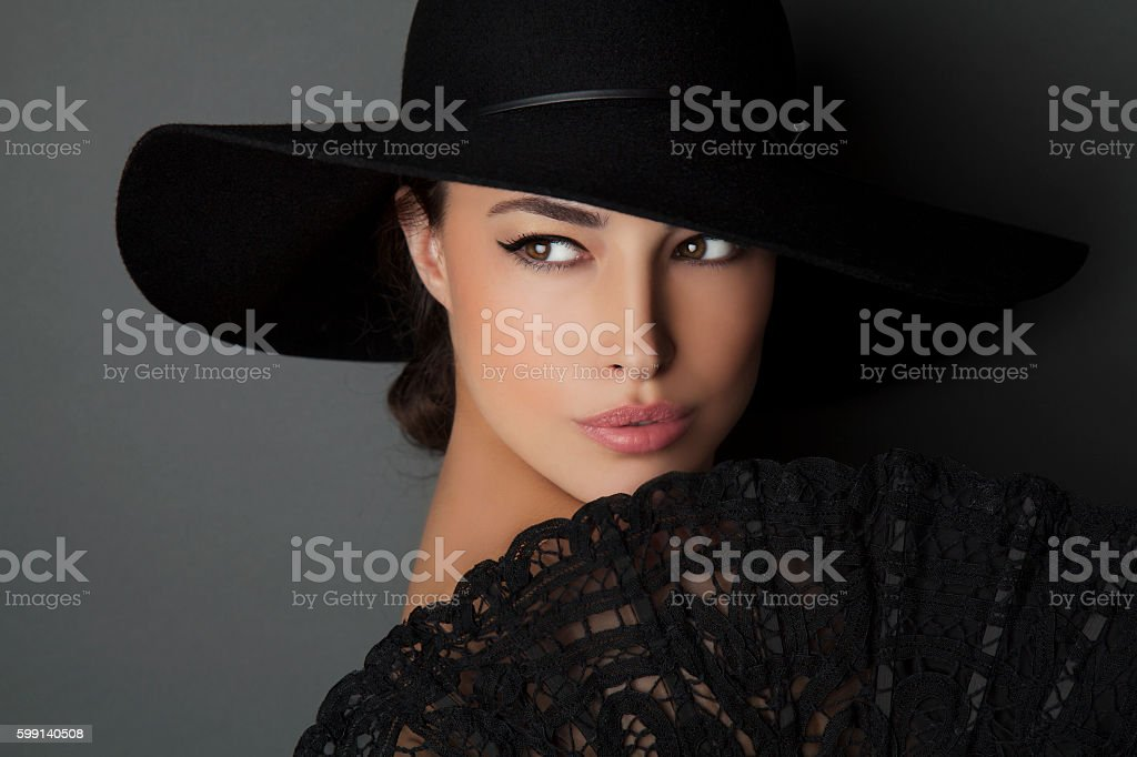 woman with black hat stock photo