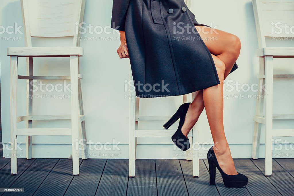 Woman with black high heels stock photo