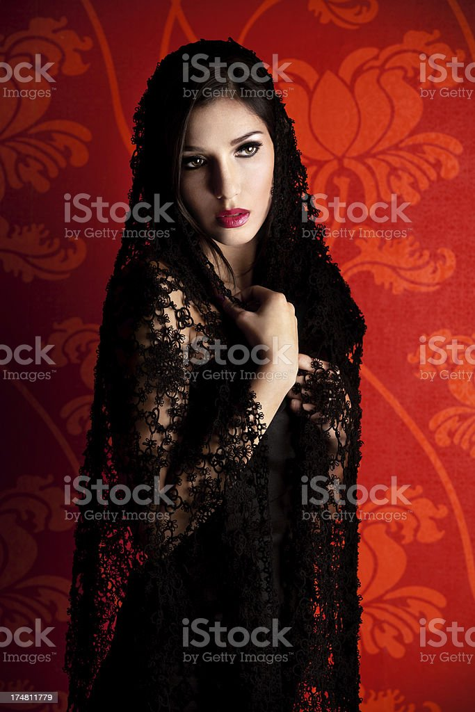 Woman with Black Lace Veil stock photo