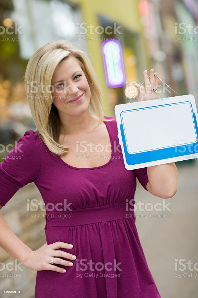 Woman with blank white sign for text royalty-free stock photo