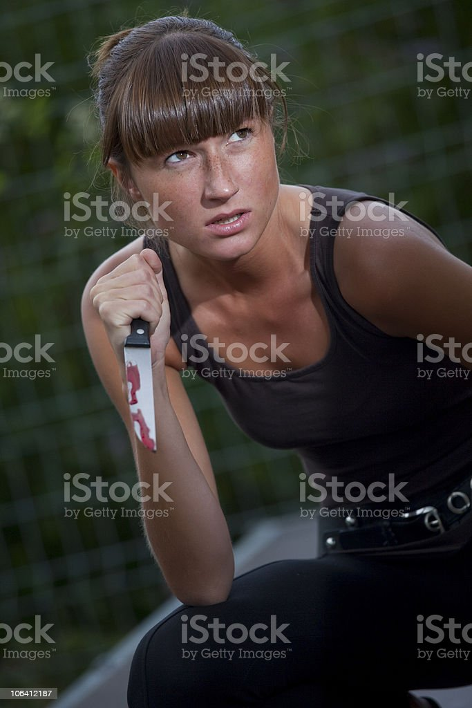 woman with bloody knife royalty-free stock photo
