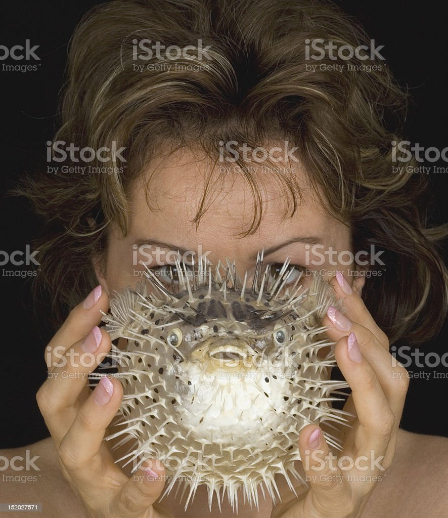 Woman with blowfish stock photo