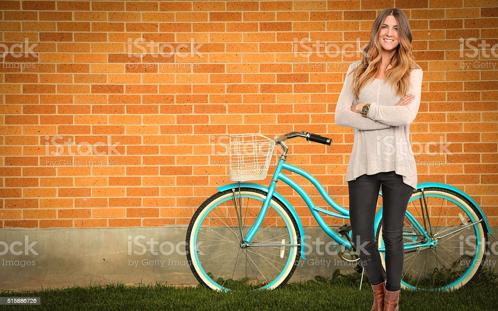 Woman With Blue Beach Cruiser Bike stock photo