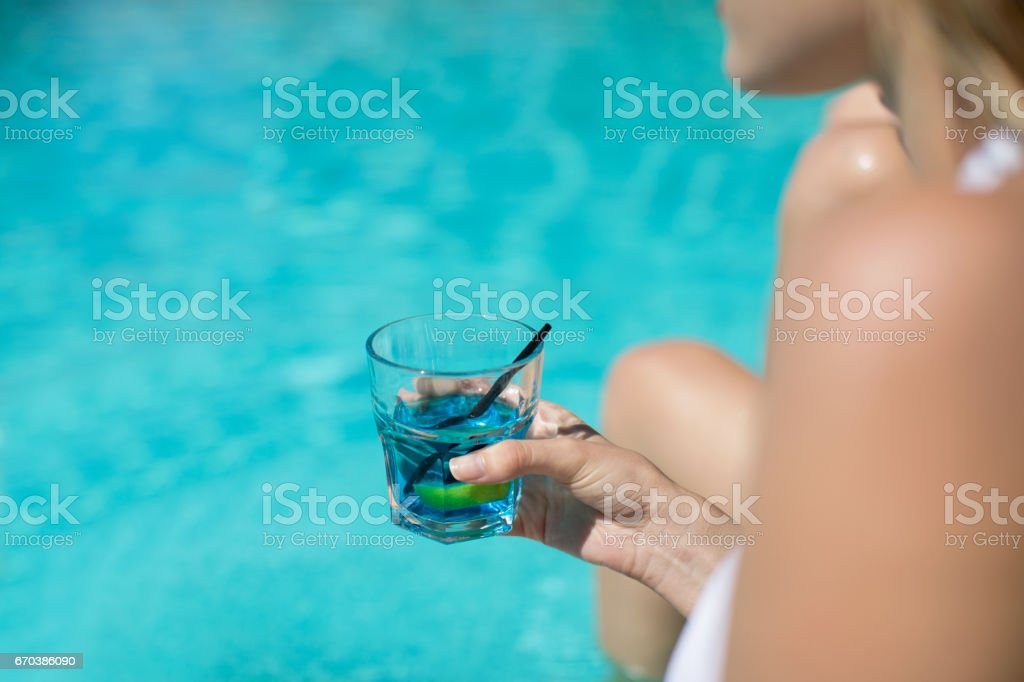 Woman with blue cocktail stock photo