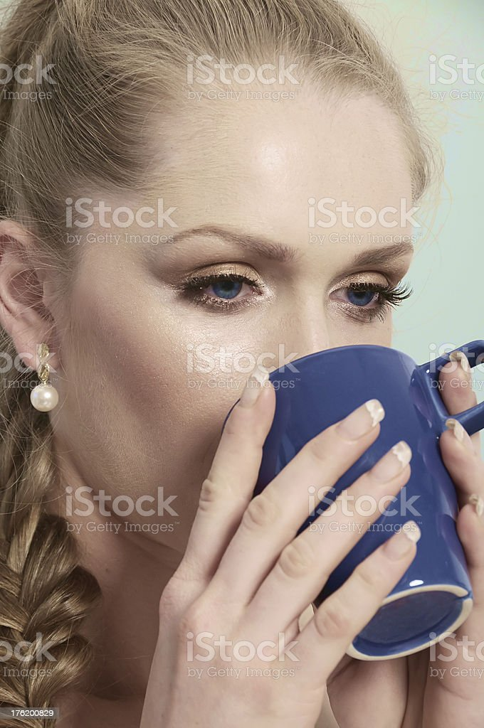 Woman with blue eyes drinking -  Coffee Girl stock photo
