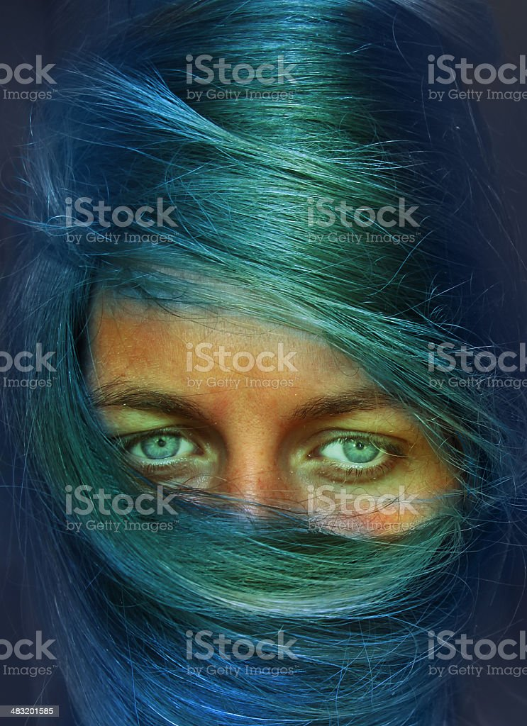 woman with blue hair stock photo