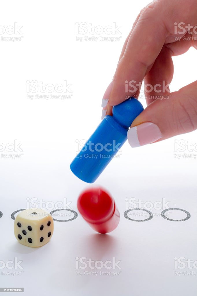 Woman with blue pawn takes red one stock photo