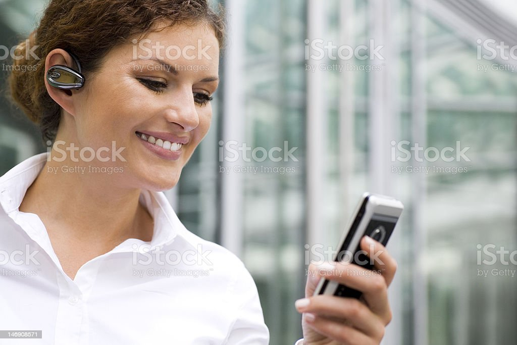 Woman with bluetooth and palmtop royalty-free stock photo
