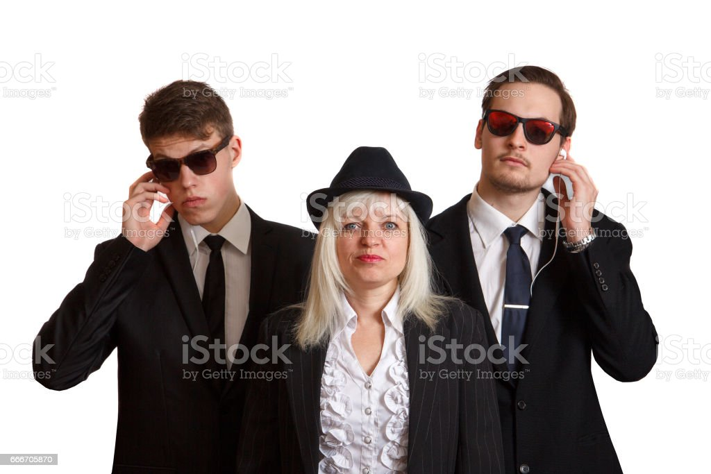 Woman with bodyguards stock photo