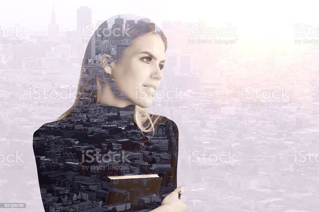 Woman with book on city background stock photo