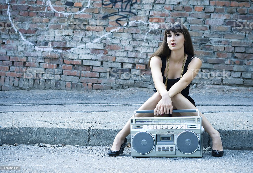 Woman with boom box on the street stock photo