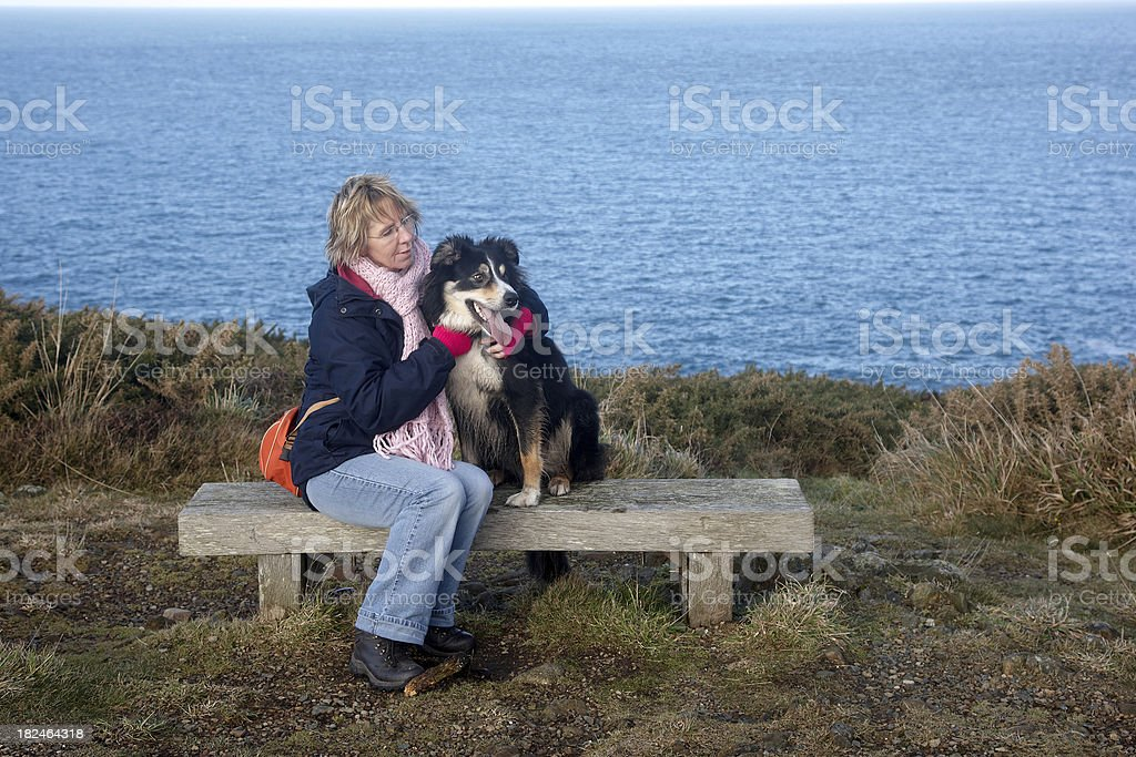 Woman with border collie dog royalty-free stock photo