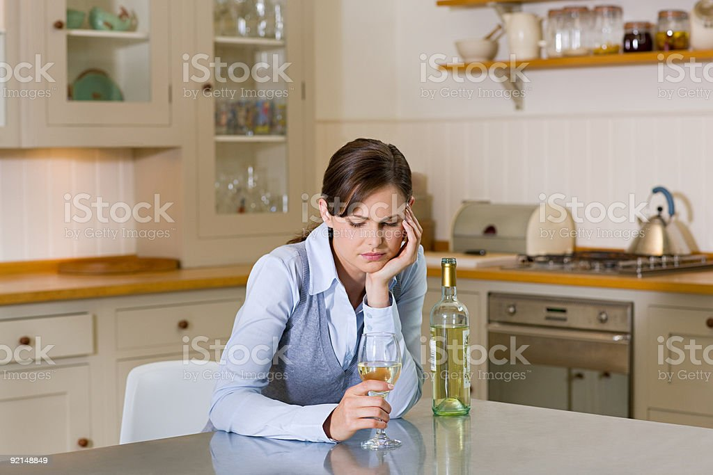 Woman with bottle of wine stock photo